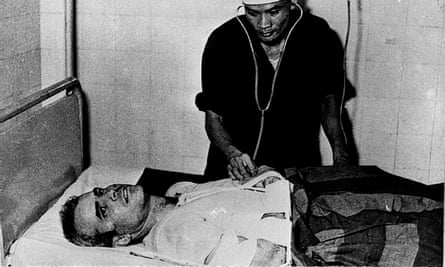 McCain is examined by a Vietnamese doctor after his capture in 1967 in Hanoi.
