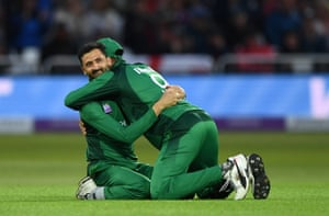 Imad celebrates with Khan after taking the catch to off his own bowling.