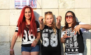 Luz Reality (center), Alix Toxik (left) and Maya La Insana (right) record a music video in Ecatepec's central plaza. 'After everything I've been through, I'm still on my feet,' raps Luz. 'I don't let myself get beaten.'