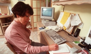 A woman working from home with desk-top computer in 1999.