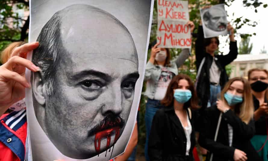 A placard depicting Alexander Lukashenko seen at a rally outside the Belarusian embassy in Kyiv on Thursday.