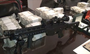 Argentinian police display money, weapons and other objects seized from former minister José López.