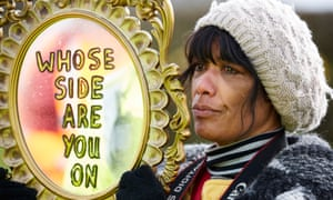 Nana Cheryl Atkinson holding up a mirror to police  that says 'Whose side are you on' as Frack Free Lancashire protesters demonstrate at a site at Preston New Road