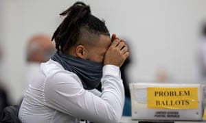 A worker with the Detroit Department of Elections takes a break after sorting through absentee ballots in Detroit.