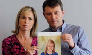 Kate and Gerry McCann in 2013, holding an age-progressed police image of their missing daughter.