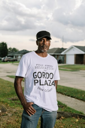 Jesse Perkins stands in the front yard of the Gordon Plaza home he moved into in 1988. Over the years, Perkins has shared the home with his mother, and now his son and granddaughter. After getting the property's soil tested for lead, Perkins decided that it was safer to keep his granddaughter from playing outside altogether.