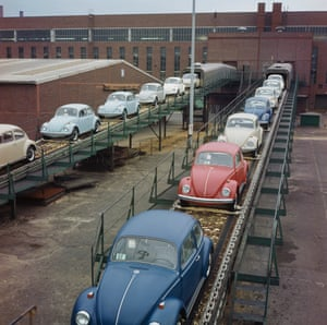 Brand new finished Beetles emerging on a conveyor belt from the production line of a Volkswagen factory in the city of Wolfsburg, West Germany in 1970.