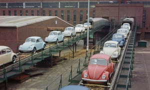 New VW Beetles emerging on a conveyor belt from the production line of a factory in Wolfsburg in West Germany in 1970.