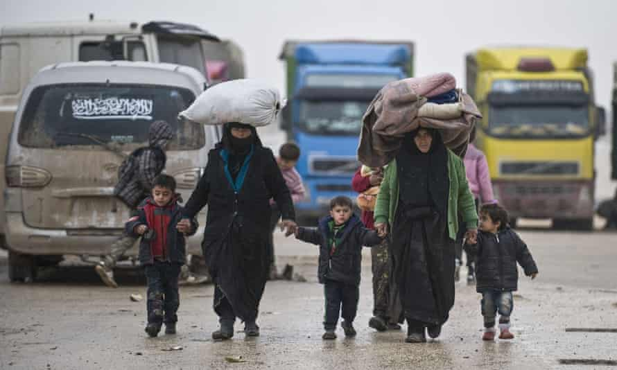 Refugees stream from Aleppo towards the Turkish border.