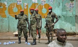 Ugandan military police patrol in the Kisekka Market area of Kampala on Thursday.