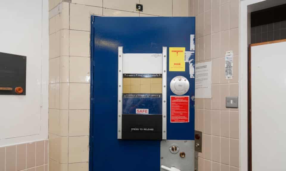 Policy custody suite door in London.