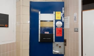 A cell door in a police station custody suite