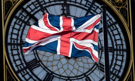 The union flag obscures the Big Ben clock face.