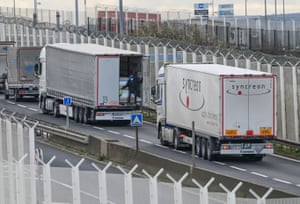 A migrant climbs into the back of a lorry bound for Britain