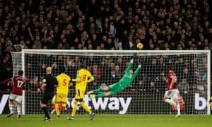 Felipe Anderson's strike flies over Wayne Hennessey for West Ham's third goal.