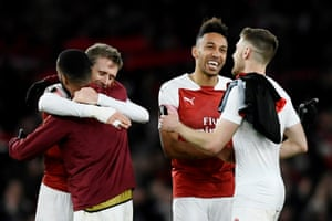Aubameyang celebrates with team mates after Arsenal win 3-0.