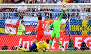 England's Jordan Pickford saves a shot from Sweden's Marcus Berg.