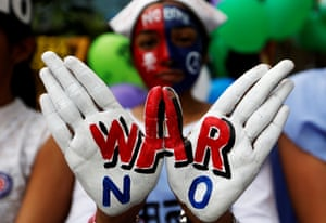 A girl with painted hands and face at peace rally in Mumbai, India