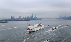 The USNS Comfort hospital ship enters New York Harbor.