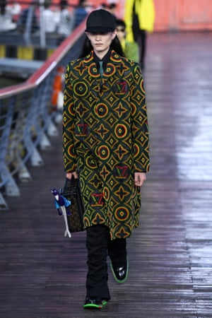 A model walks the runway during the Louis Vuitton S/S21 men's collection show.