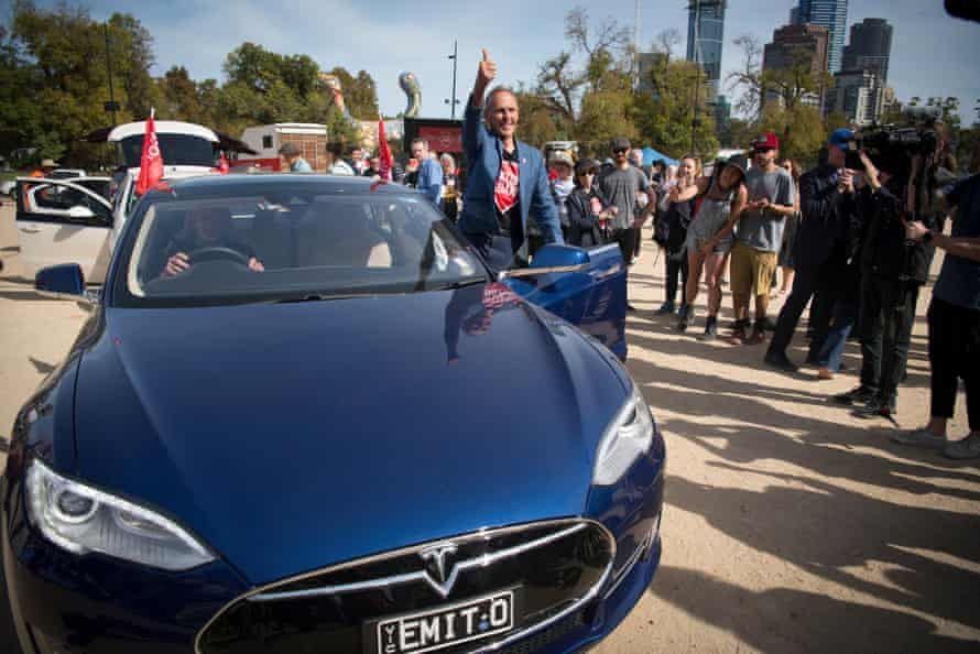 Bob Brown gets into a Tesla electric car in Melbourne that was loaned to him for the Stop Adani convoy