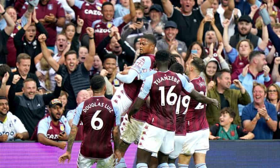 Aston Villa players and fans celebrate after Everton's Lucas Digne scored an own goal to make it 2-0