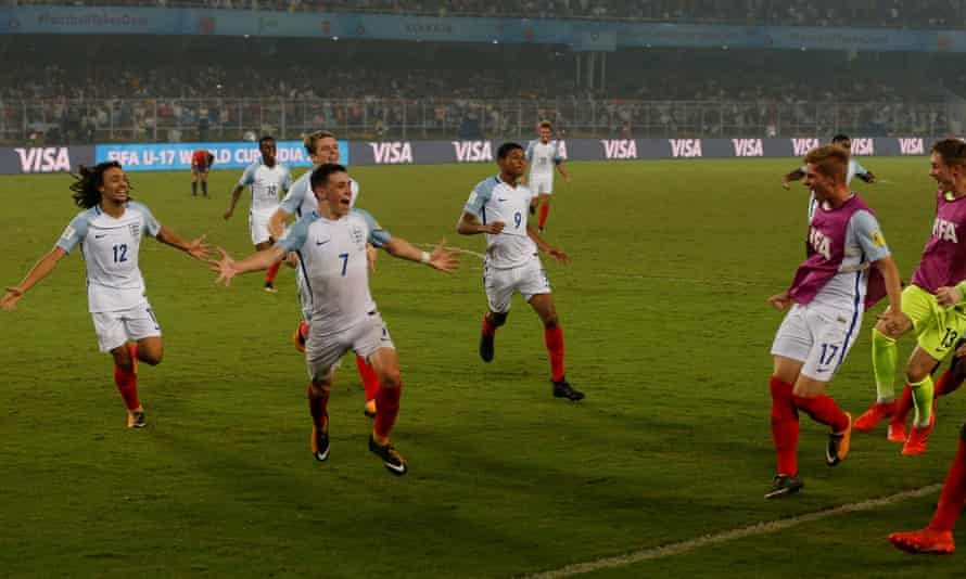 England's Phil Foden, No7, celebrates scoring their fifth goal with his team-mates.