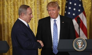 Donald Trump wears a long blue tie as he shakes hands with Israeli prime minister Benjamin Netanyahu at the White House on 15 February 2017