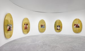 Calculatedly unremarkable … Wolfson's brass ovals, each printed with a childhood photograph.