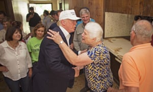 Donald Trump, center, comforts flood victim Olive Gordan with her husband Jimmy, right, during tour of their flood damaged home in Denham Springs, La., Friday, Aug. 19, 2016.