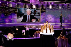 Honoree Norman Lear accepts the Carol Burnett award via video while co-host Amy Poehler listens