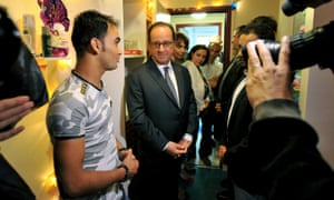 François Hollande meets an Afghan migrant at a shelter and orientation centre in Tours