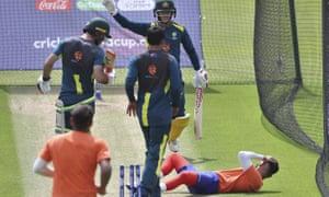 Australia's David Warner calls for medical help after hitting a net bowler