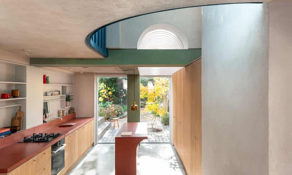'We've never aspired to the 'house beautiful' look, but it was starting to look tatty': the garden glimpsed through the rear doors of the kitchen.