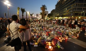 Floral tributes, notes and candles placed in the road for victims of the Bastille Day attack in Nice.