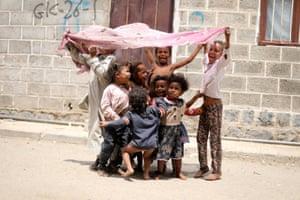 Sanaa, Yemen. Children from the Muhamasheen community play outside