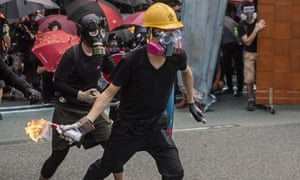 A protester gets ready to throw a molotov cocktail at the police during a rally in Hong Kong on Sunday.