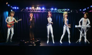 Alexis sings along with a holographic version of the band at ABBAWorld, an exhibition devoted to the pop band Abba, in Earls Court, London.