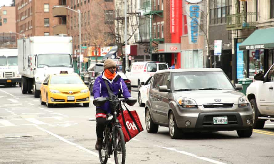 A cyclist travels through New York city amidst the global outbreak