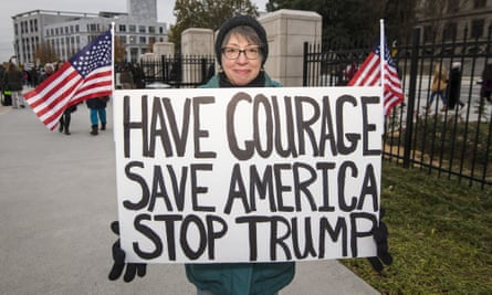 Protesters at Georgia's capitol building call on members of the state electoral college to vote against Donald Trump.