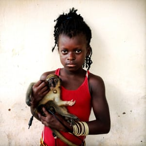 Mariama, 10, and her pet monkey whose leash is made from a repurposed piece of electrical cord. Taken in Bolama, Guinea Bissau. Follow Holly on Instagram: @hollypickettpix