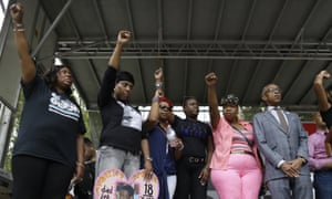 The Rev Al Sharpton, right, is joined on stage by mothers of those killed by police or vigilantes: Oscar Grant's mother, Wanda Johnson, left; Ramarley Graham's mother, Constance Malcolm, second from left; Michael Brown's mother, Leslie McSpadden, third from left; Trayvon Martin's mother, Sybrina Fulton, third from right; and Eric Garner's mother, Gwen Carr, during a rally in New York in 2015.