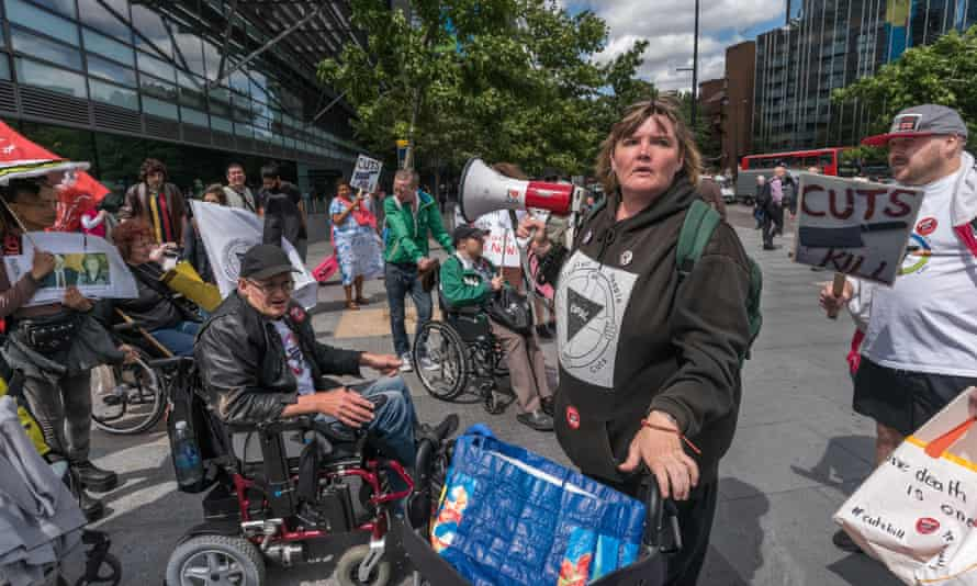PIP protesters in London, July 2017outside Atos over their false and inaccurate PIP assessments which are resulting in the deaths of disabled peopleJK68YA July 21, 2017 - London, UK - London, UK. 21st July 2017. Paula Peters gathers the protesters by the Euston Road crossing after their protest outside Atos over their false and inaccurate PIP assessments which are resulting in the deaths of disabled people who lose benefits. DPAC then ended their week of action during the London Para Athletics World Championships by blocking one carriageway of the Euston Road at Warren St for around ten minutes. The two police officers present asked them to move and then radioed for reinforcements, who arrived just after the protesters left the road. DPAC say th