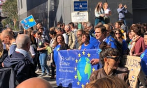 eu staff for climate in brussels holding a banner