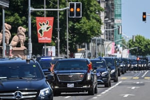 The car carrying Biden drives in a motorcade to the villa