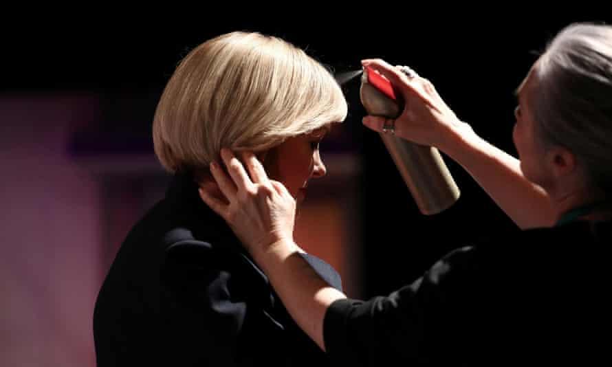 National leader Judith Collins has her hair sprayed.