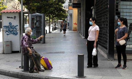 A man solicits the charity of passersby in Beirut