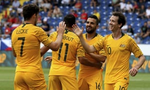 Mathew Leckie celebrates the opening goal with Australia team-mates Andrew Nabbout, Aziz Behich and Robbie Kruse.