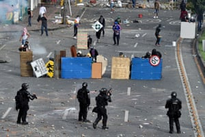 Demonstrators clash with riot police at a protest against a proposed government tax reform in Cali, Colombia.
