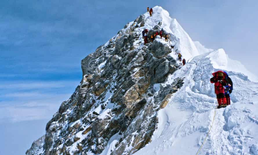 Climbers descending the Hillary Step on Everest in 2010.